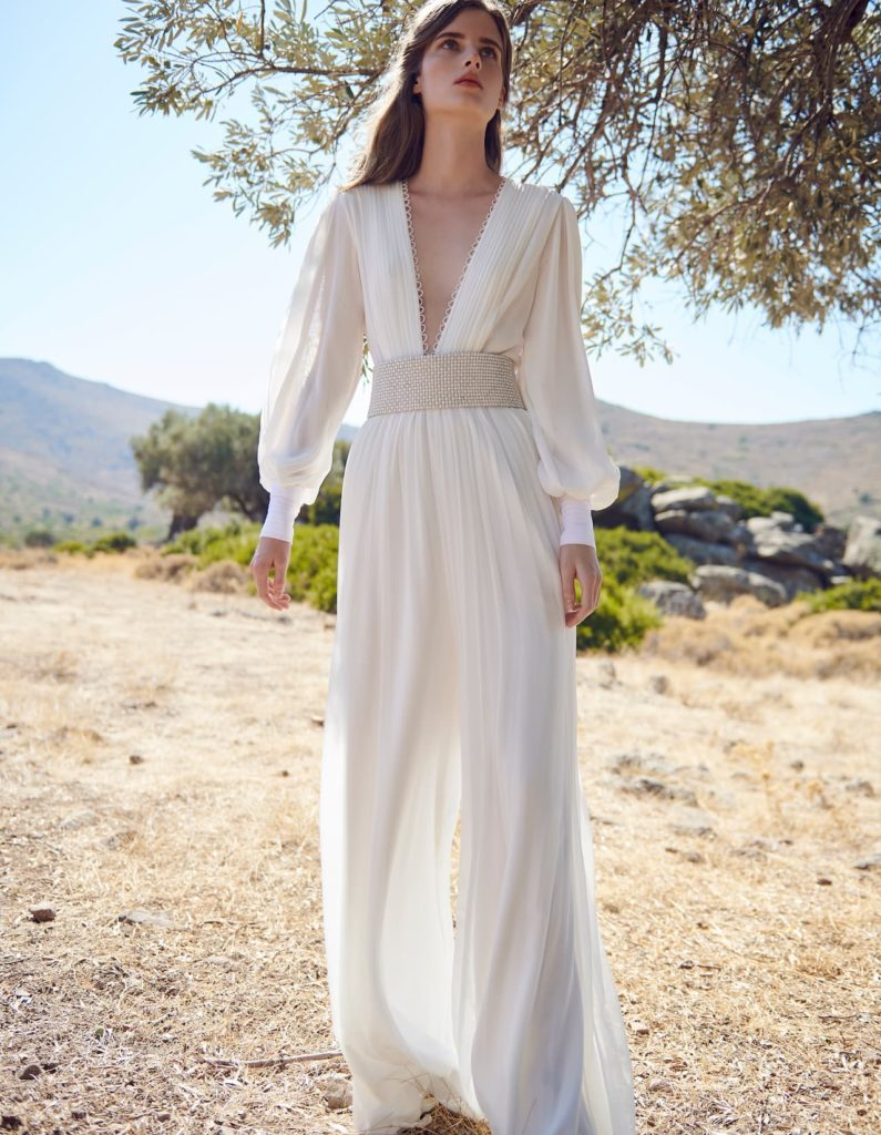 Wedding jumpsuit - Delicately sensual, Cassandra jumpsuit is made with silk chiffon with a plunging neckline and decorated with pleats and button loop details.